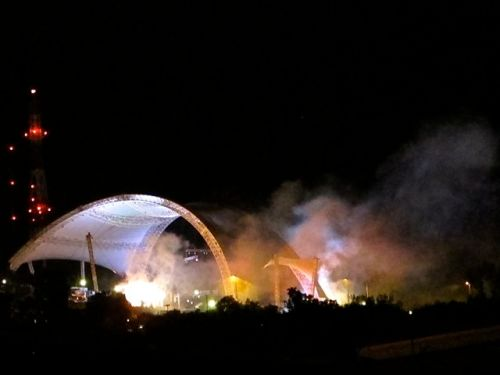 Night shot of colored smoke billowing from Guelaguetza Auditorium.