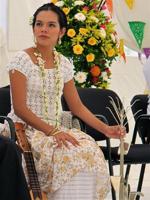 Evelin Acosta López seated.