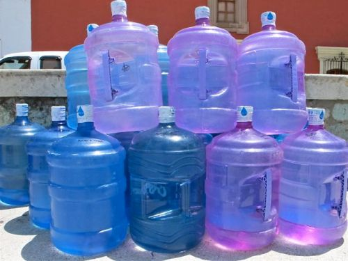 Stack of garafons (jugs) of pure water.