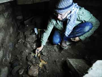Archaeologist in Zapotec tomb