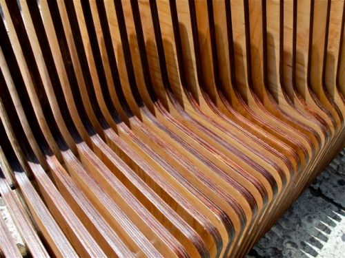 Slats of curved pieces of wood forming a bench