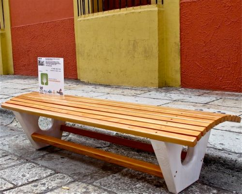 Wooden bench with a curved seat.