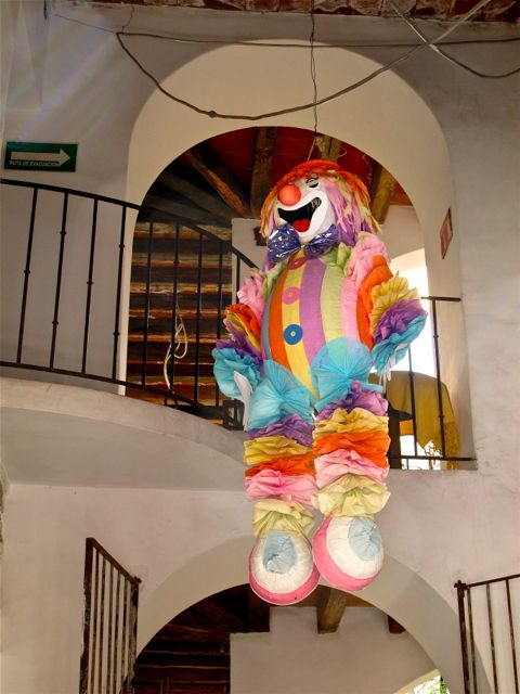 Clown piñata hanging from a ceiling