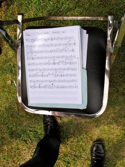 "On a chair: sheet music ""Zapateando Istmeño xxx"" for tuba"