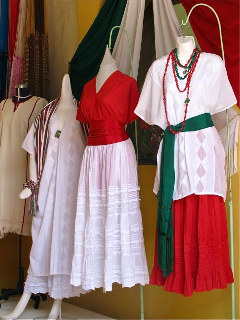 Green, white, and red dresses, skirs, blouses, and sash.