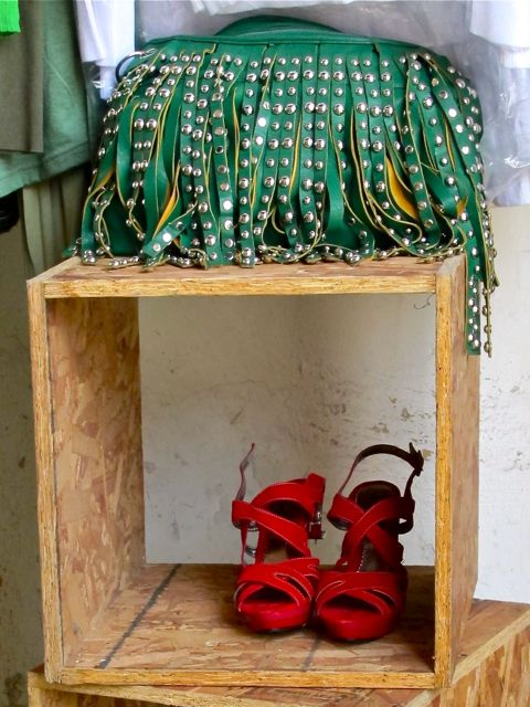 Green purse and red shoes.