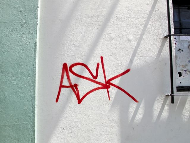 """The word """"ASK"""" written on white wall with light green trim on left"""
