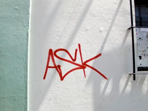 "The word ""ASK"" written on white wall with light green trim on left"