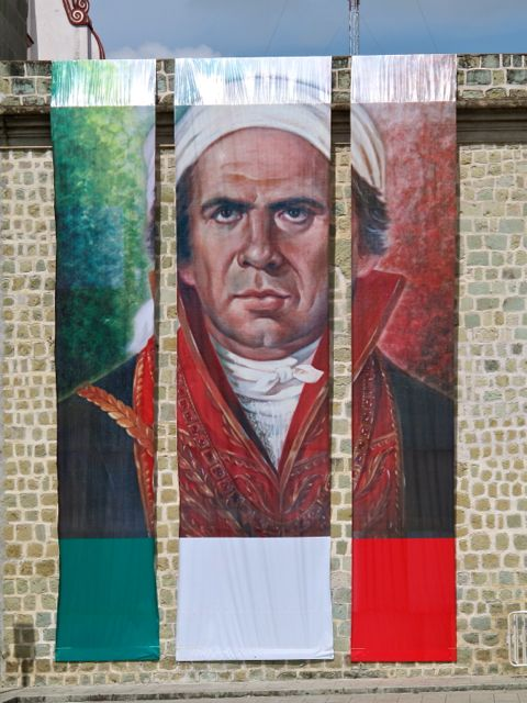 Massive 3-piece banner portrait of Morelos hanging from wall of Oaxaca's Municipal Building