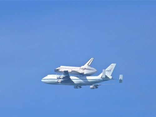 Close-up of space shuttle Endeavor riding on top of Boing 747 against clear blue sky
