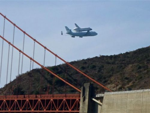 Endeavor above the north side of the Golden Gate Bridge and the Marin Headlands