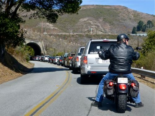 Cars and motorcycle waiting to go through tunnel of Marin Headlands.