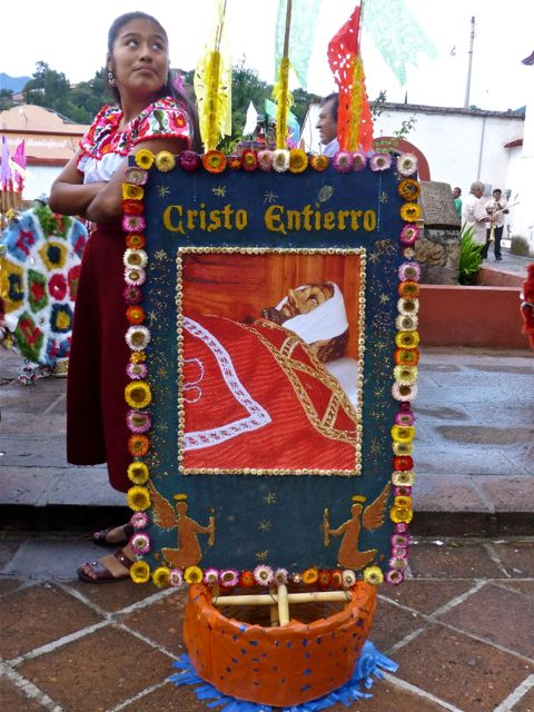 Decorated canasta with image of bandaged head of Jesus.