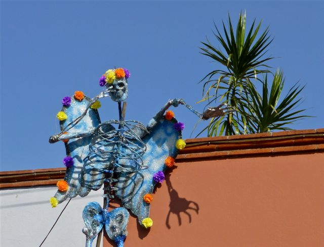 Decorated skeleton on top of building.
