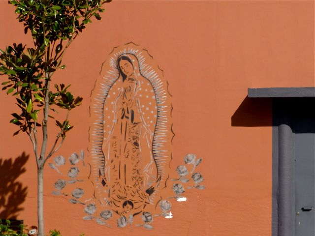 Virgin of Guadalupe image stenciled on a wall