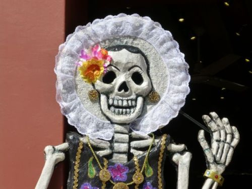 Close-up of Tehuana Catrina with hand raised