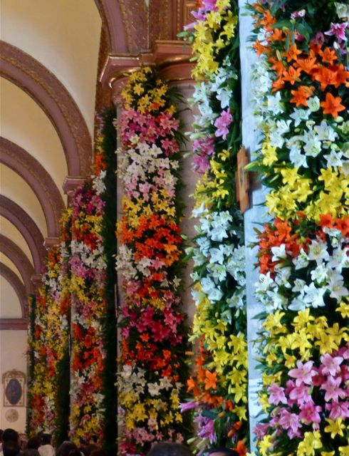 Pillars covered in multicolored lilies