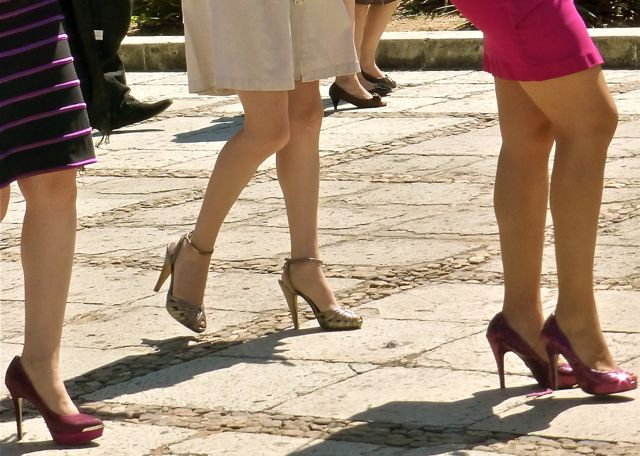 Lower legs and feet of 3 women wearing high heels