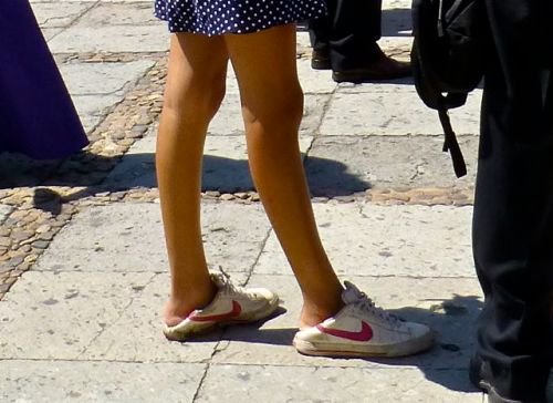 Lower legs of a young woman wearing gym shoes