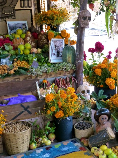 Marigolds, photos, fruit, vegetables, skulls, drum, baskets of nuts