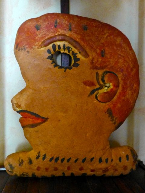 Bread in the shape of the profile of a woman's face