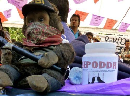 Plush monkey wearing bandana across his face.