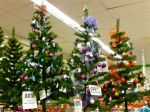 Three decorated Christmas trees with 30% discount signs