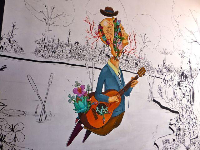 Mural on the wall outside Academia de Arte Musical in Oaxaca.