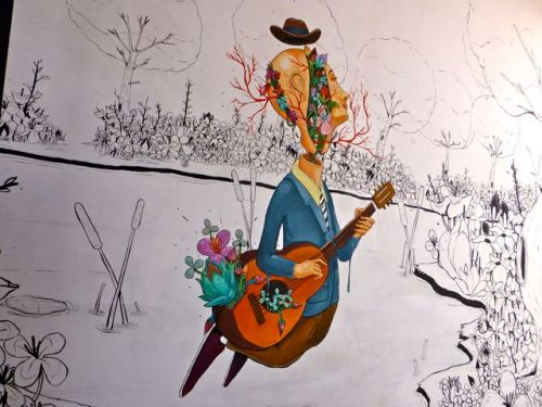 Mural on the wall outside Academia de Arte Musical in Oaxaca.