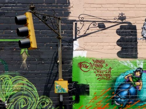 Wall art with painted shadow of stoplight