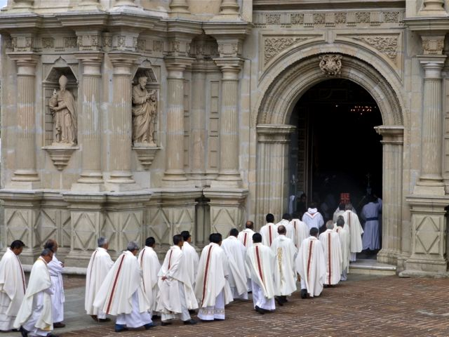 Procession of priests entering the Basilica