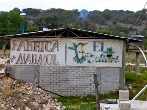 Concrete block building with sign, Fabrica Marmol, El Colibrí