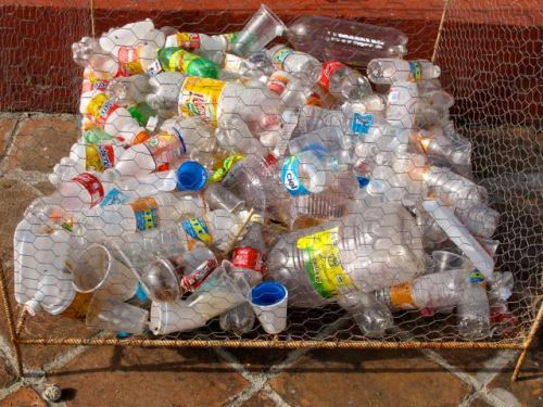 Chicken wire bin 1/3 full of plastic bottles