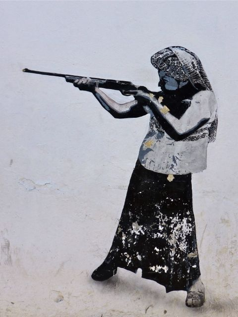 Woman pointing rifle