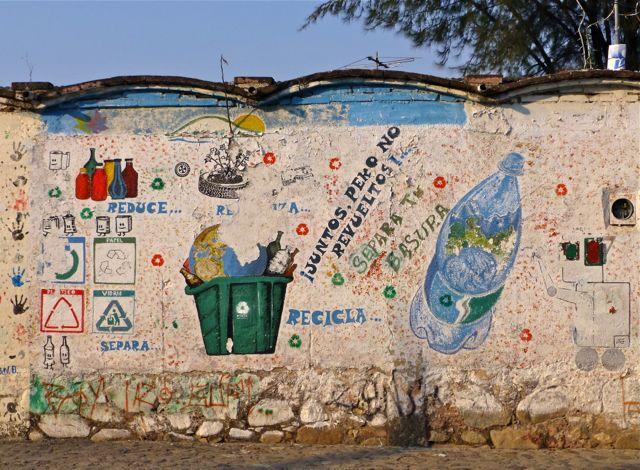 "Wall art demonstrating ""reduce, separa, recicla"""