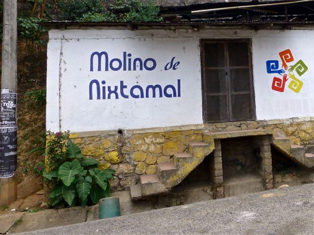 "Sign painted on side of building ""Molino de Nixtamal"""