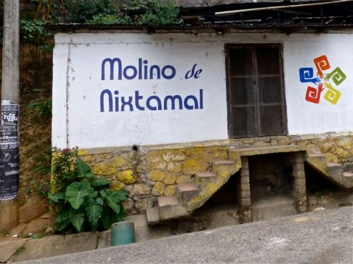 "Sign painted on side of building ""Molino de Nixtamal"""