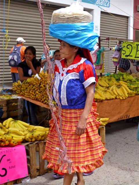 Woman carrying tlayudas on head