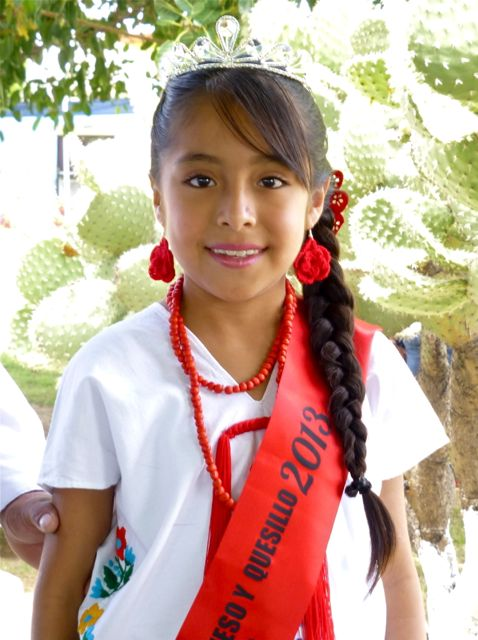 Girl with crown and red sash