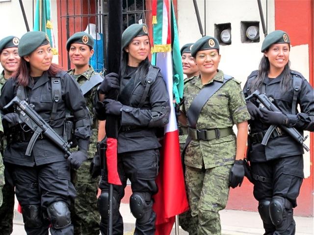 Young women in military uniform posing