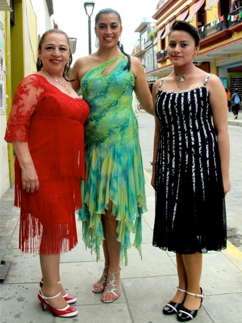 3 women dressed in glittery dresses