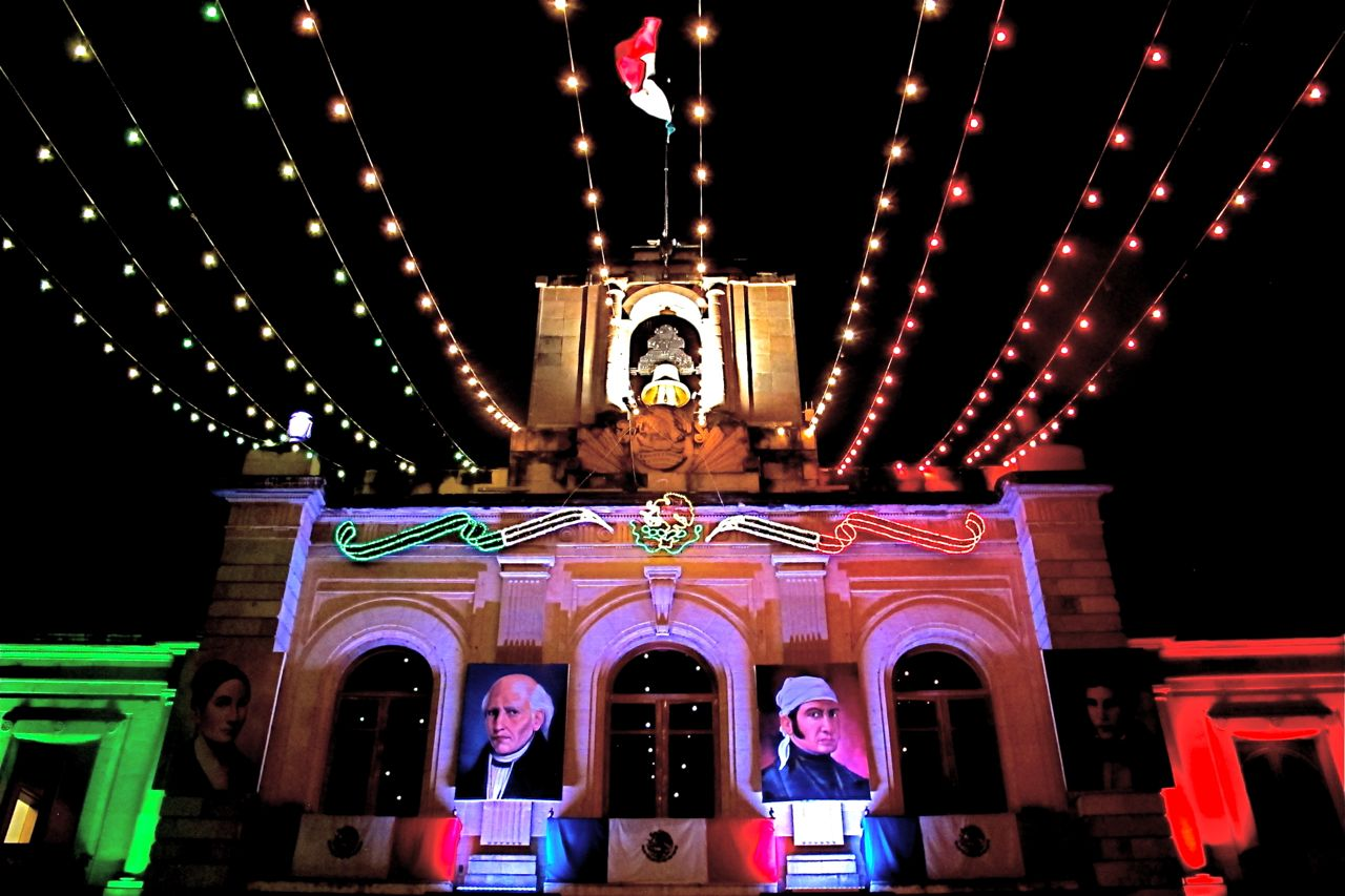 Government Palace lit with green, white, & red lights