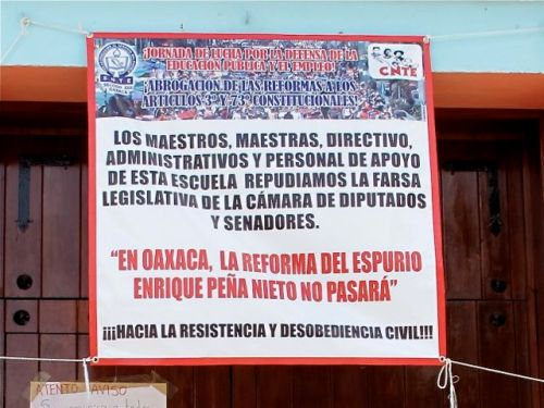 Banner hanging in front of a school in Oaxaca city