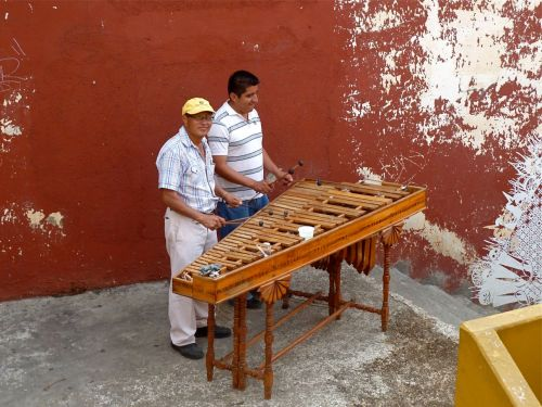 2 men playing marimba
