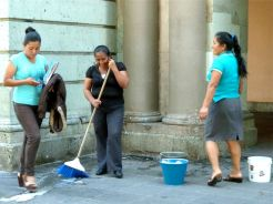Woman with broom and bucket