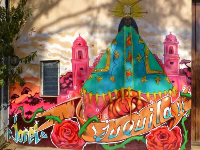 La Virgen de Juquila painted on side of building