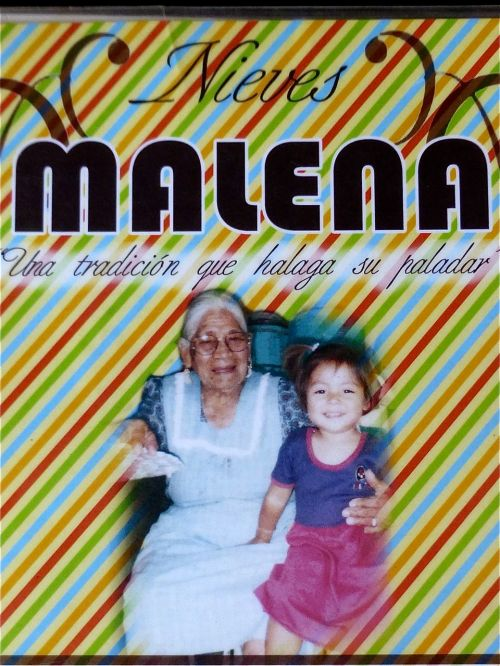 Placard with an image of Señora Malena and a granddaughter