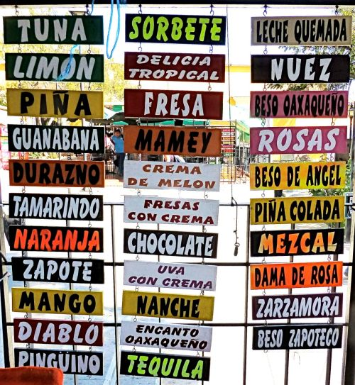 Hanging plaques listing flavors