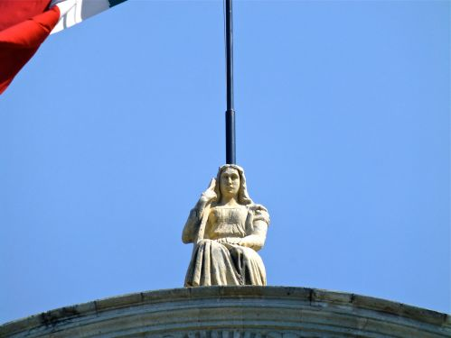Seated female statue on top of Cathedral
