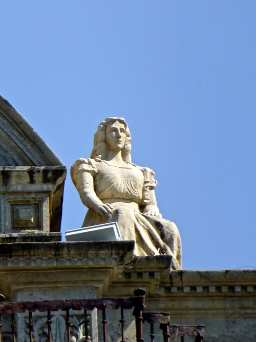 Standing female statue on top of Cathedral